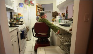 Wheelchair user trying to maneuver within confined kitchen space.
