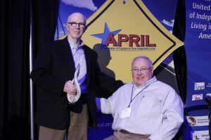 Dr. Tom Seekins and Dr. Glen White posing after Dr. Seekins accepts his award from Dr. White.