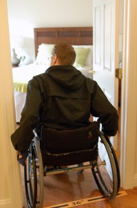 "wheelchair user going through accessible 36"" doorway"