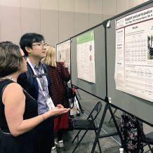 Dr Rayna Sage presenting her poster at APHA 2017 conference