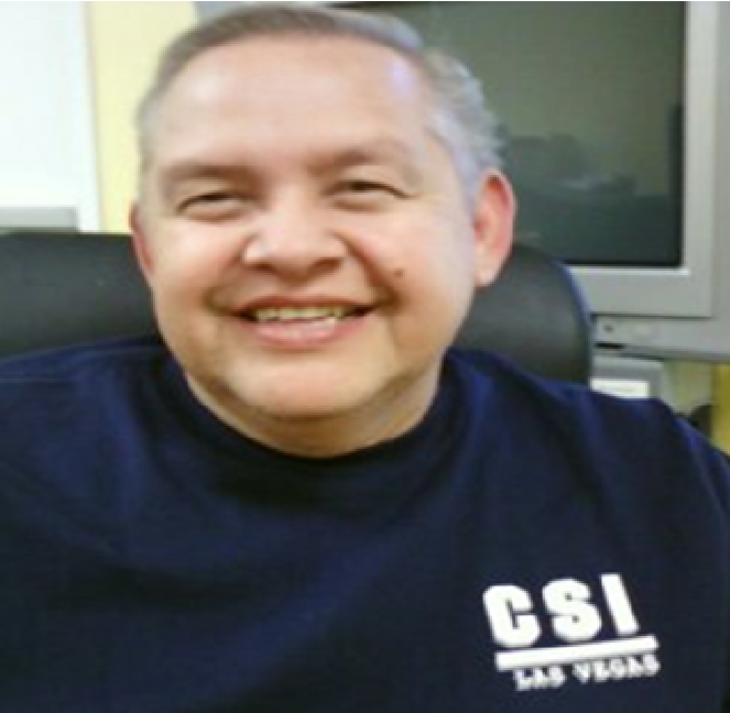 Bert Rios, a man with short grey hair in a blue sweatshirt smiles
