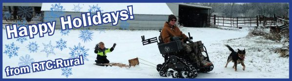 Happy Holidays! From RTC:Rural. A person using a motorized wheelchair pulls a child on a sled. A dog runs next to them.
