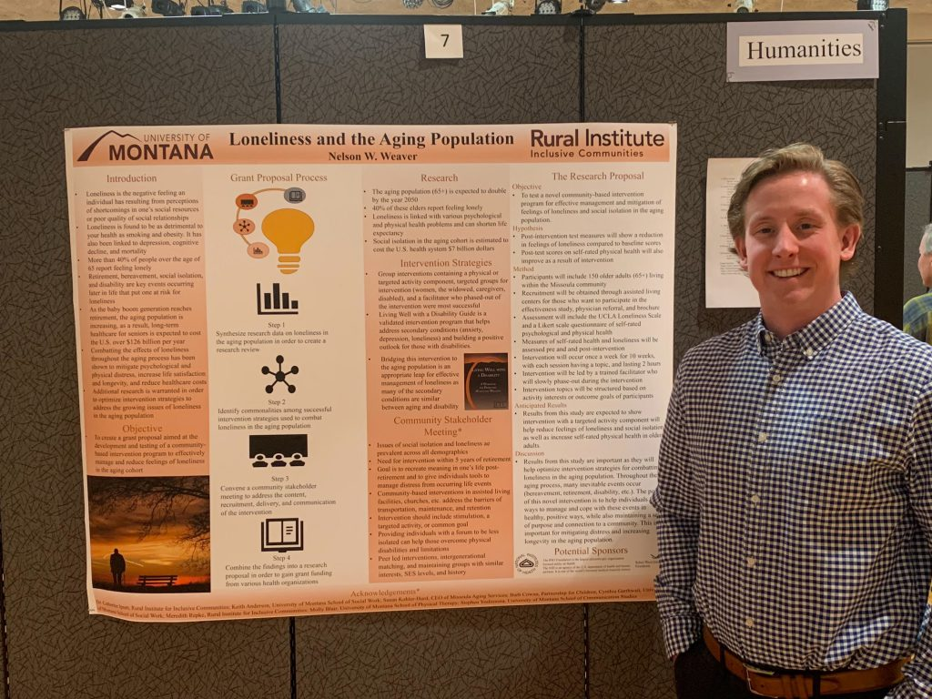 Nelson Weaver stands next to his research poster at the UM undergraduate research conference.
