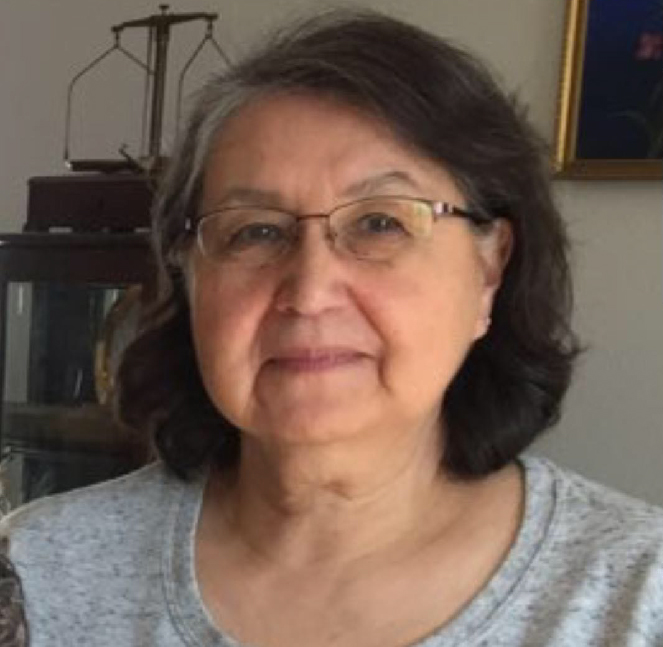 Irene Merchant an older woman with a grey shirt and glasses