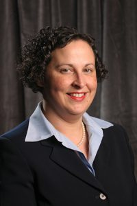 Professional headshot of Dr. Adriane Griffen