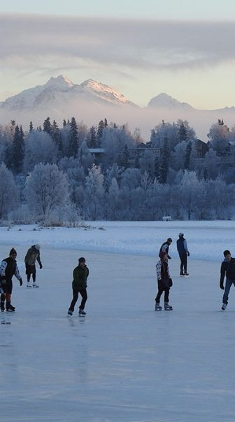 ice skaters under mountain