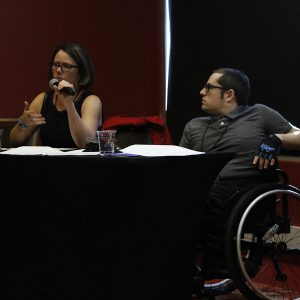 two speakers at a workshop, one using a wheelchair