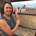 Rayna Sage at a rodeo with mountains in the background