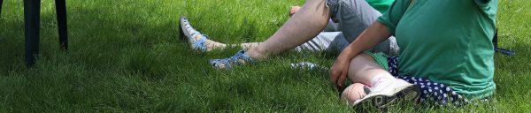 women sitting in grass
